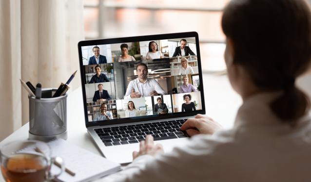 Woman facing computer on Zoom